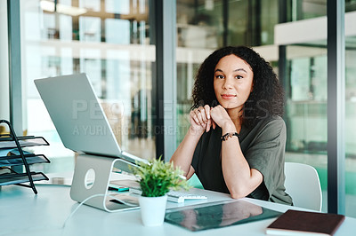 Buy stock photo Portrait of a young businesswoman sitting at her desk