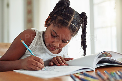 Buy stock photo Cropped shot of a young girl coloring in at home