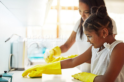 Buy stock photo Cropped shot of a little girl and her mother cleaning at home