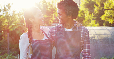 Buy stock photo Cropped shot of an affectionate young couple standing side by side on their farm
