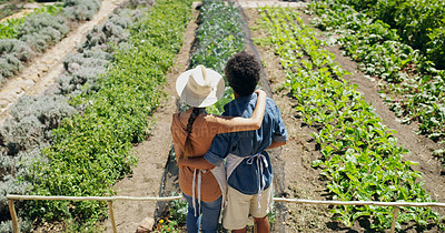 Buy stock photo Rearview shot of an affectionate young couple standing in the fields on their farm