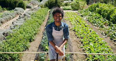 Buy stock photo High angle portrait of a handsome young man standing in the fields on his farm