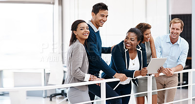 Buy stock photo Cropped shot of a happy group of colleagues sharing a laugh together in the office