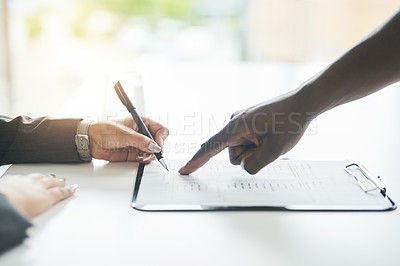 Buy stock photo Cropped shot of an unrecognizable businessman and businesswoman going over paperwork together in a modern office