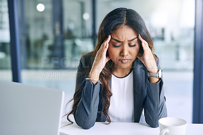 Buy stock photo Shot of a young businesswoman suffering from stress while working in a modern office
