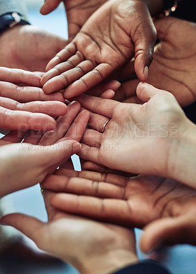 Buy stock photo Cropped shot of a group of businesspeople with their hands opened