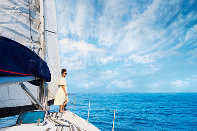 Buy stock photo Shot of a young woman enjoying a relaxing day on a yacht