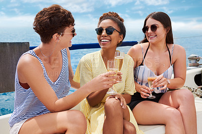 Buy stock photo Shot of a group of happy young women having champagne on a cruise