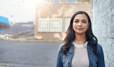 Buy stock photo Portrait of an attractive young woman out in the city