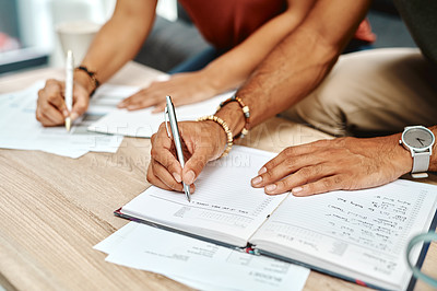 Buy stock photo Cropped shot of a couple going over their finances together at home