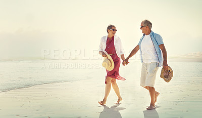 Buy stock photo Full length shot of an affectionate senior couple enjoying their day out on the beach