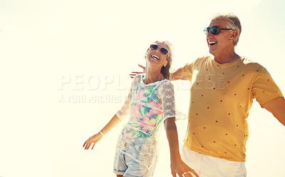 Buy stock photo Cropped shot of an affectionate senior couple enjoying their day out on the beach