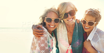 Buy stock photo Cropped shot of a group of senior friends enjoying their day out on the beach