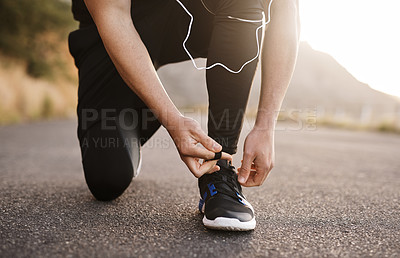 Buy stock photo Shot of a young man exercising outdoors