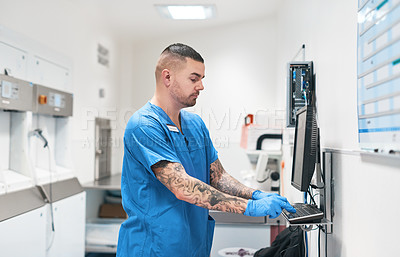 Buy stock photo Shot of a medical diagnostic specialist working on medical equipment inside of a hospital during the day