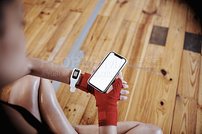 Buy stock photo Shot of an unrecognizable sportswoman using her cellphone at the gym
