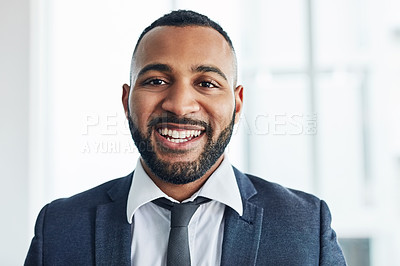 Buy stock photo Portrait of a handsome young businessman standing in his office