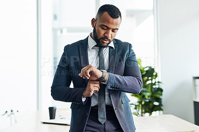 Buy stock photo Cropped shot of a businessman checking the time
