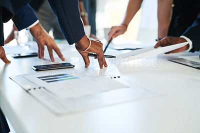 Buy stock photo Shot of unrecognizable businesspeople having a meeting around a table in an office
