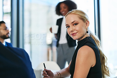 Buy stock photo Portrait of a beautiful young businesswoman during a boardroom meeting with colleagues