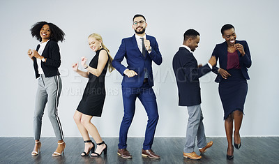 Buy stock photo Studio shot of a group of businesspeople dancing against a grey background