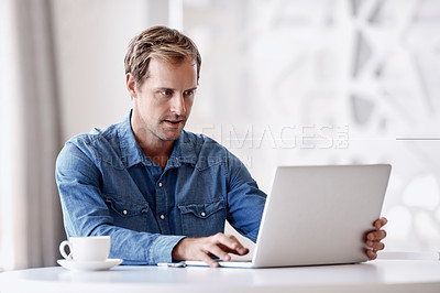 Buy stock photo Cropped shot of a handsome mature businessman using his tablet while sitting in the office