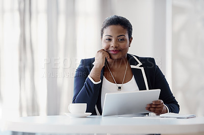 Buy stock photo Cropped portrait of an attractive young businesswoman looking thoughtful while working on her tablet in the office