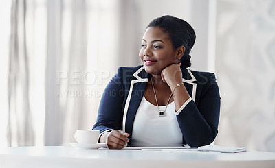 Buy stock photo Cropped shot of an attractive young businesswoman looking thoughtful while sitting behind her desk in the office