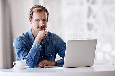 Buy stock photo Cropped portrait of a handsome mature businessman looking thoughtful while working on his laptop in the office