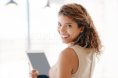 Buy stock photo Cropped portrait of an attractive young businesswoman using her laptop while standing in the office