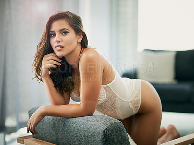 Buy stock photo Portrait of a beautiful young woman wearing lingerie in her bedroom at home