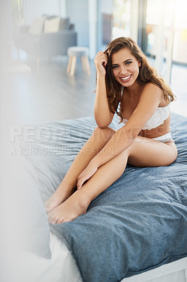 Buy stock photo Full length shot of a beautiful young woman in lingerie posing on her bed in her bedroom at home