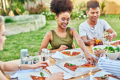 Buy stock photo Cropped shot of a group of young friends enjoying a meal at a dinner party outside in the afternoon