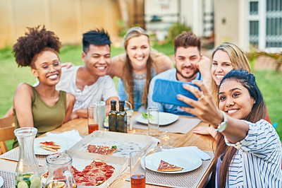 Buy stock photo Cropped shot of a group of young friends taking a self portrait together at a dinner party in the afternoon