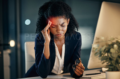 Buy stock photo Shot of a young businesswoman looking stressed out while working in an office at night
