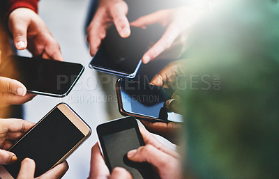 Buy stock photo Cropped shot of a group of people using their phones together