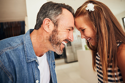Buy stock photo Shot of an adorable little girl spending quality time with her father at home