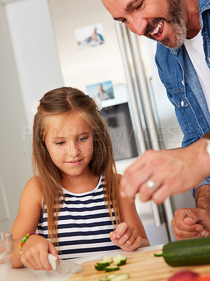 Buy stock photo Shot of an adorable little girl cooking with her father at home