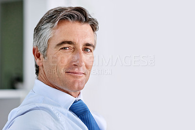 Buy stock photo Headshot of a confident mature businessman wearing a suit and tie while sitting indoors