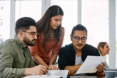 Buy stock photo Shot of a group of young businesspeople having a meeting in a modern office
