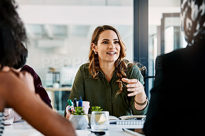 Buy stock photo Shot of three young businesswomen having a meeting together at work