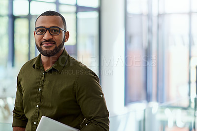 Buy stock photo Portrait of a handsome middle aged  businessman holding a digital tablet while standing inside of the office