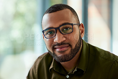 Buy stock photo Portrait of a handsome middle aged  businessman seated inside of the office