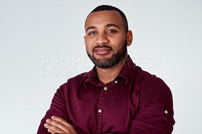 Buy stock photo Studio portrait of a confident young businessman standing against a grey background