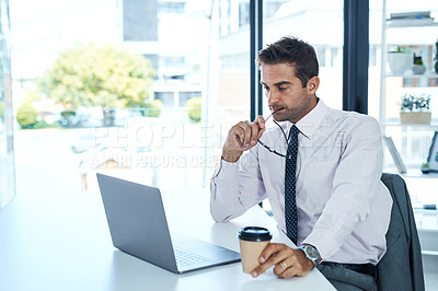 Buy stock photo Cropped shot of a businessman sitting at his desk