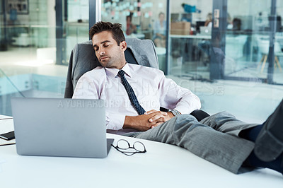 Buy stock photo Shot of a businessman sleeping at his desk