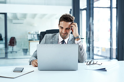 Buy stock photo Cropped shot of a businessman looking confused while sitting at his desk