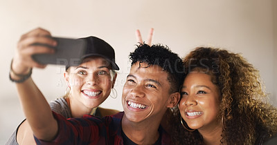 Buy stock photo Cropped shot of a young diverse group of dancers standing against a walled background and smiling for a selfie