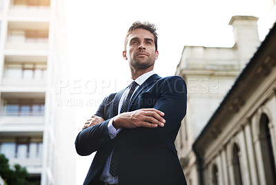 Buy stock photo Shot of a handsome young businessman on his morning commute to work