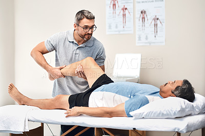 Buy stock photo Shot of a senior man going through rehabilitation with his physiotherapist